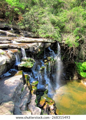 Waterfall on small river. Shot in Paradise Valley Nature Reserve, Durban, South Africa.  - stock photo