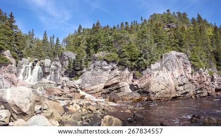 Waterfall on the coast of Atlantic Ocean, Cape Breton, Nova Scotia, Canada - stock photo