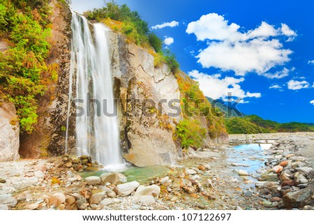 waterfall on the way to Fox glacier - stock photo