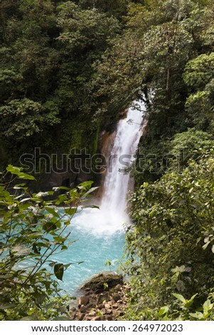 Waterfall Rio Celeste (sky blue river) at Tenorio Volcano National Park. - stock photo