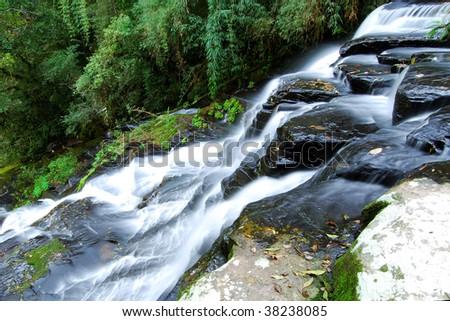 Waterfall stairs on atlantic rain-forest. - stock photo