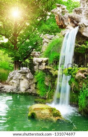 Waterfall sunlit - stock photo