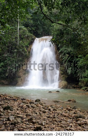 waterfall surrounded of tropical vegetation, Dominican Republic - stock photo