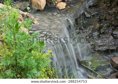 waterfall water flowing nature stream plant falling green - stock photo