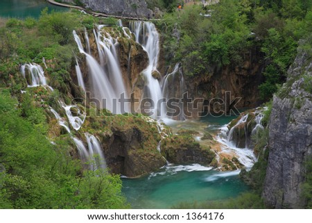waterfall with lake - stock photo