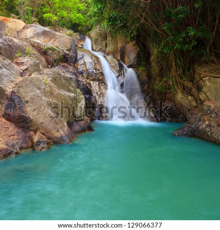 Waterfall with pool in tropical jungle, Na Muang, Koh Samui - stock photo