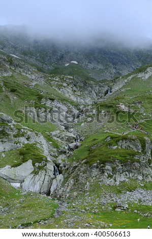 Waterfalls in the foggy Rila mountains in Bulgaria in the summer - stock photo