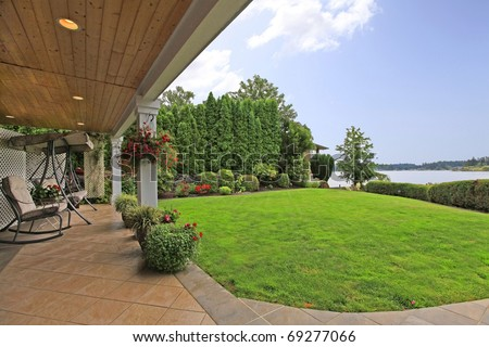 Waterfront lake home with dock and terrace. - stock photo