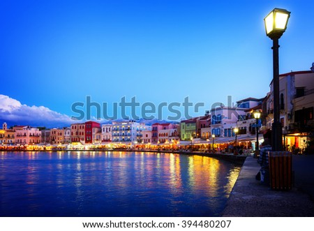 waterfront of venetian habour of Chania with  Aegan sea at night, Crete, Greece, toned - stock photo