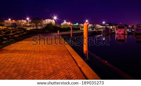 Waterfront walkway at the Bay Bridge Marina at night, in Kent Island, Maryland. - stock photo