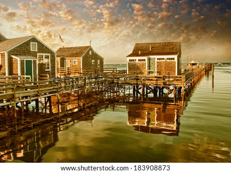 Waterfront with wooden homes and ocean. Vintage filtered - stock photo