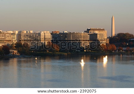 Watergate Complex and Washington Monument in DC at sunset - stock photo