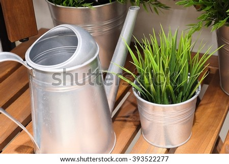 Watering Can or Watering Pot with Green Plants, Watering Can Used to Water Plants by Hand. - stock photo
