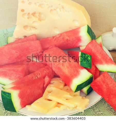 Watermelon and cheese for snack or dessert. Mediterranean country style . Farm natural food for lunch or snack of mediterranean. Image done in vintage instagram style - stock photo