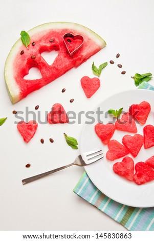 Watermelon cut into heart shape - stock photo