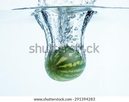 Watermelon in water splash - stock photo