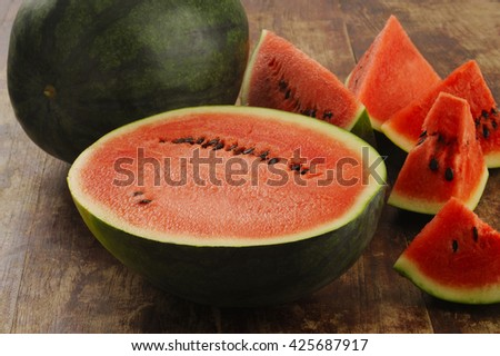watermelon on wooden background - stock photo
