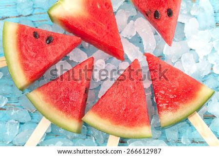 watermelon popsicle raw food yummy fresh summer fruit sweet dessert on vintage old wood teak blue - stock photo