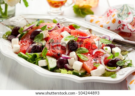 Watermelon Salad with Feta,Cucumber,Olive  and Mint - stock photo
