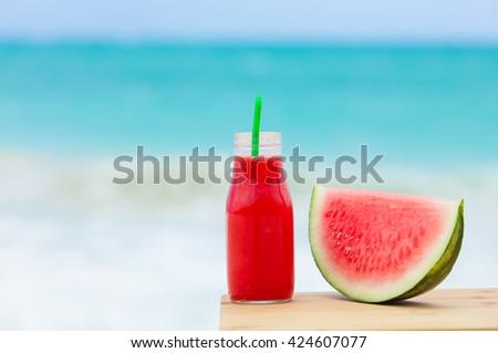 Watermelon shake on a beach setting.  - stock photo