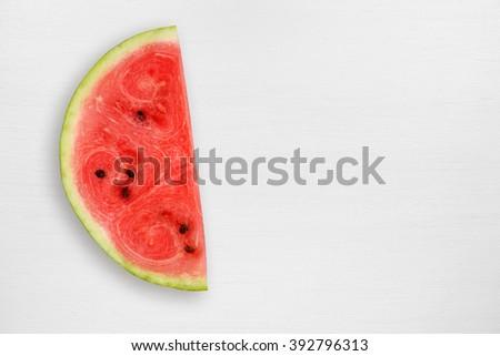 Watermelon slice on white table - stock photo