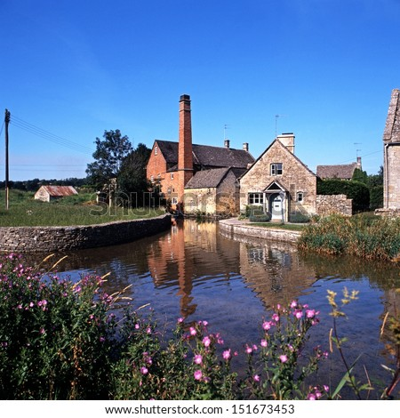 Watermill on the River Eye, Lower Slaughter, Gloucestershire, Cotswolds, England, UK, Western Europe. - stock photo