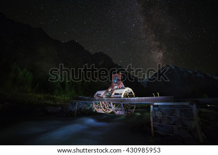 Watermill under the starlight in Aktru mountaineering camp in the Altai Mountains. Siberia. Russia - stock photo