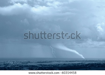 waterspout  with lightning incumbent  on the city - stock photo