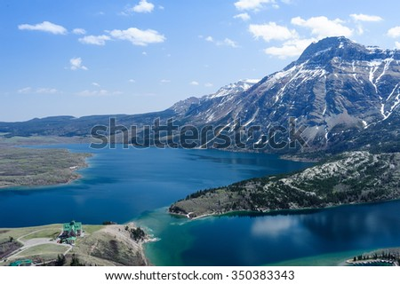 Waterton lake with aerial view of Prince of Wales Hotel in Waterton Lakes National Park, Alberta, Canada - stock photo