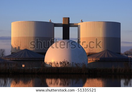 Watertreatment plant in warm winter light. - stock photo