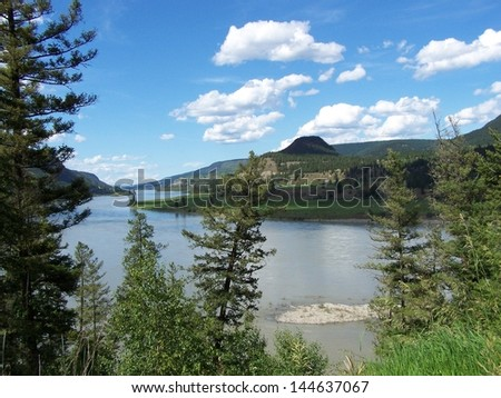 Waterway view from the trees - stock photo