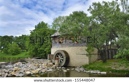 waterwheel from the grant old mill in Winnipeg Manitoba - stock photo