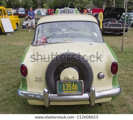 WAUPACA, WI - AUGUST 25: Rear of 1959 Nash Metropolitan Checker Taxi Cab car at the 10th Annual Waupaca Rod & Classic Car Club Car Show on August 25, 2012 in Waupaca, Wisconsin. - stock photo