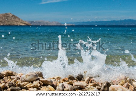 wave and drops at the beach ( close up ) - stock photo