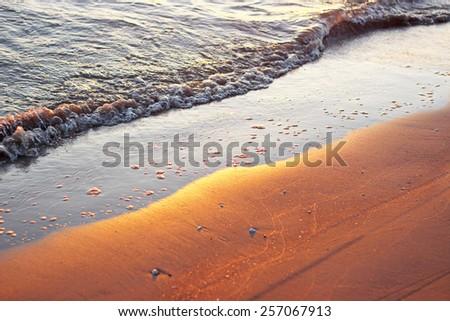wave and sea sand, summer morning, sun  - stock photo