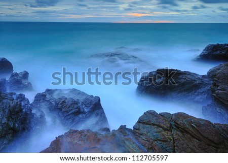 Wave and stone - stock photo