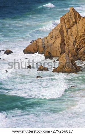 Wave and stone in Cabo da Roca, Areia, geographical point of western Europe, Portugal. - stock photo