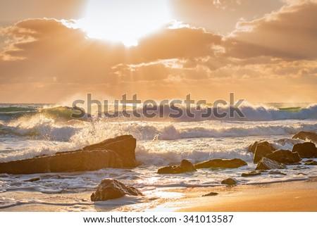 Wave crashing on the rocky reef. - stock photo
