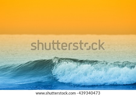 wave in the ocean at sunset in summer - stock photo