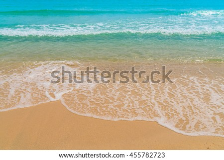 Wave of sea on the sand beach - stock photo