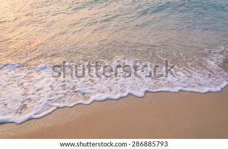 wave of sea on the sandy beach. - stock photo