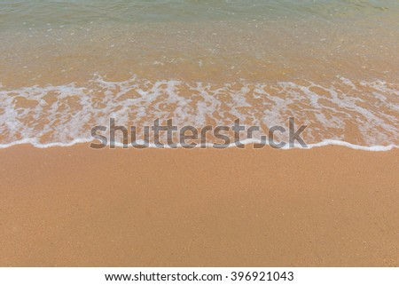 wave of sea on Tropical beach in Andaman Thailand. - stock photo