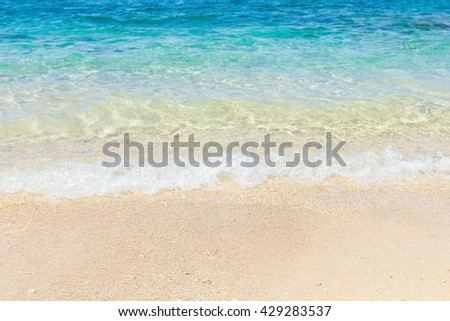 wave of sea water on beach, summertime - stock photo
