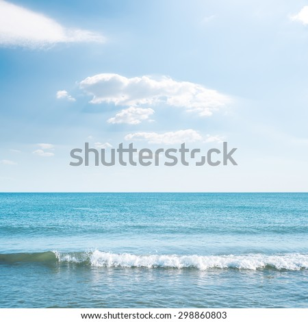 wave on sea and blue sky with clouds - stock photo