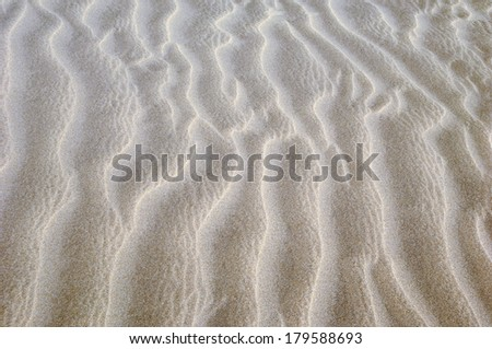 wave pattern background in the sand - stock photo
