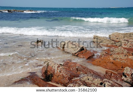 Waves, a blue sky and a sunny beach, a perfect place for summer holidays - stock photo