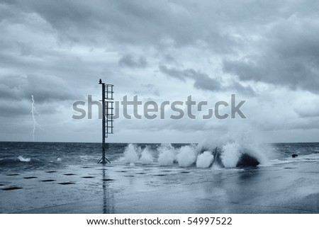 waves and lightning on the pier - stock photo