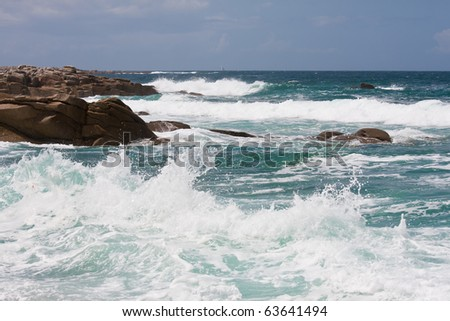 Waves breaking at rocky coast of Brittany, France - stock photo