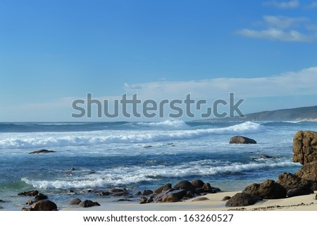 Waves breaking off rocky coastline, Quinninup Beach, Western Australia - stock photo