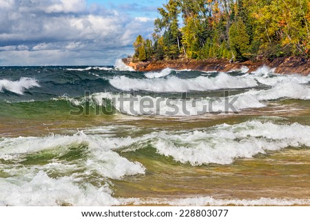 Waves crash on the rocky coast of Lake Superior at Michigan's Pictured Rocks National Lakeshore in autumn. Shot in Michigan's Upper Peninsula not far from Munising. - stock photo